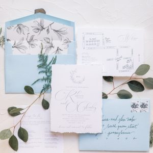 deckled edge wedding invitation watercolor blue envelopes