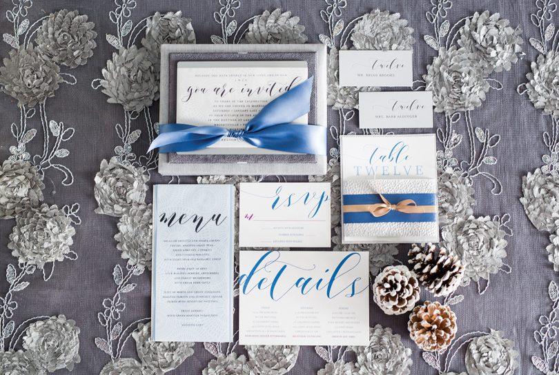 Custom invitation in silver silk box