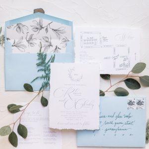 deckled edge wedding invitation watercolor blue envelopes